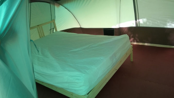Inside glamping tent showing double bed